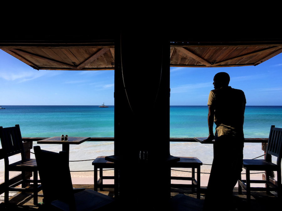 An LGBT rights activist looks out over a beach and the Caribbean Sea on the eastern Caribbean island of Barbados. (Amy Braunschweiger photo courtesy of Human Rights Watch)