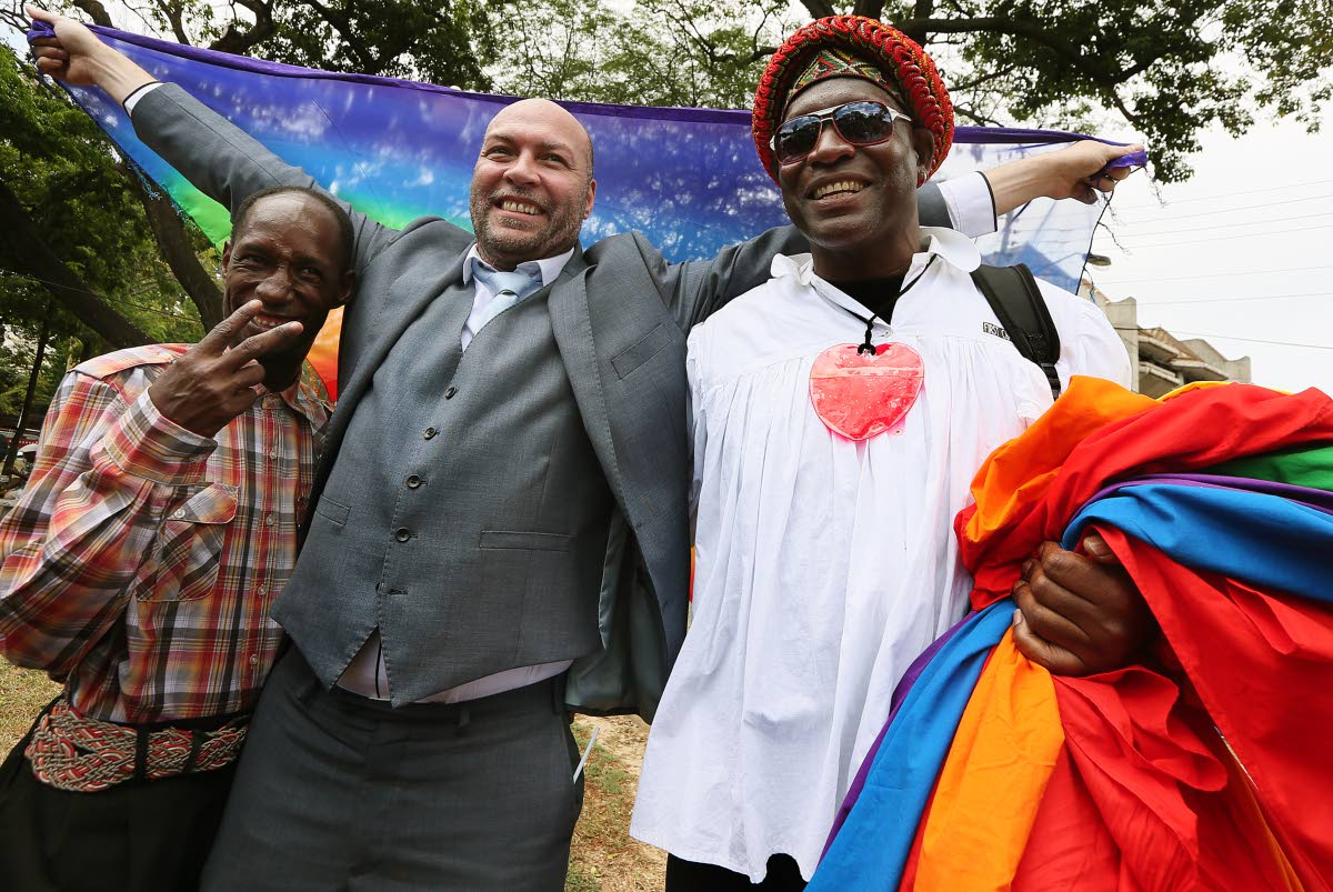 Human rights activist Jason Jones celebrates in Port of Spain, Trinidad, with Kelvin Darlington (Saucy Pow), left, and another member of the LBGTQI community after the high court's ruling decriminalising sodomy. (Azlan Mohammed photo courtesy of Newsday of Trinidad)
