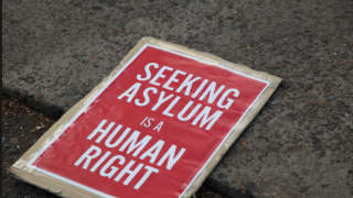 With this photo, the African Human Rights Coalition explains its support for asylum-seekers from Uganda and other anti-LGBT nations.