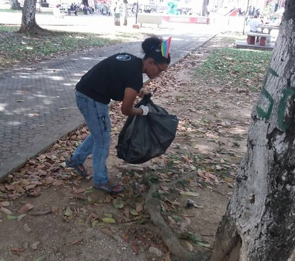 LGBT+ community and friends picked up six bags' worth of litter in Woodford Square during anti-LGBT rally. (Photo courtesy of Facebook)
