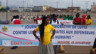 Marchers in Yaoundé, Cameroon, celebrate the Day of Remembrance of the Fight Against Violence Targeting Human Rights Defenders. (Photo courtesy of Steeves Winner)