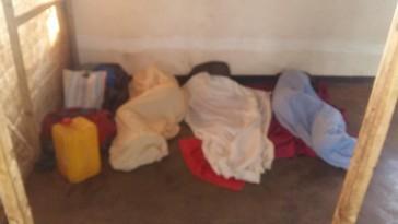 Three Ugandan LGBTI refugees sleep on the ground in Malawi. (Photo courtesy of Rainbow Flag Kakuma)