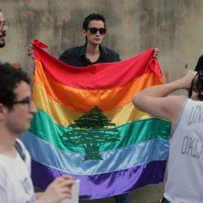 LGBT rights demonstrator displays combination of Lebanon's flag and a rainbow flag (AFP photo courtesy of Annahar.com)