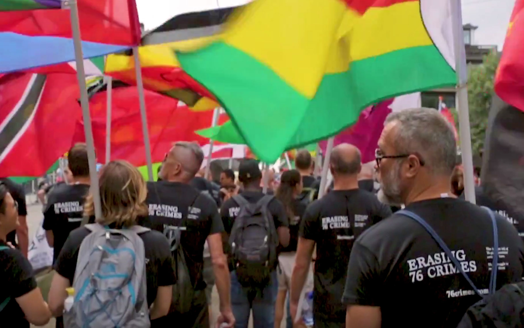 During Amsterdam Pride 2018, marchers in Erasing 76 Crimes t-shirts carried the flags of repressive nations to pressure them to repeal their anti-LGBT laws.