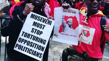 Protesters in London demand an end to repression in Uganda and the release of singer and opposition politician Robert Kyagulanyi, whose stage name is Bobi Wine. (Photo courtesy of the African Equality Foundation)
