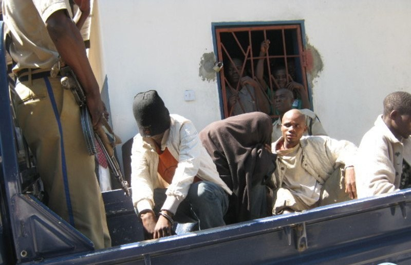 After their conviction in Zambia on Aug. 3 for gay sex, Japhet Chataba and Stephen Sambo are loaded into a pickup truck to be transported back to jail. (Photo courtesy of Lusaka Times)