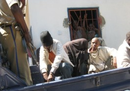 After their conviction in Zambia on Aug. 3 for homosexual activity, two men are loaded into a pickup truck to be transported back to jail. (Photo courtesy of Lusaka Times)