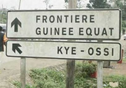 Road sign shows the way to Kyé-Ossi and to the border with Equatorial Guinea.