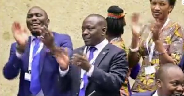 Gay rights opponents from Uganda cheer the defeat of a proposal for the Inter-Parliamentary Union to discuss anti-gay discrimination and rights abuses.