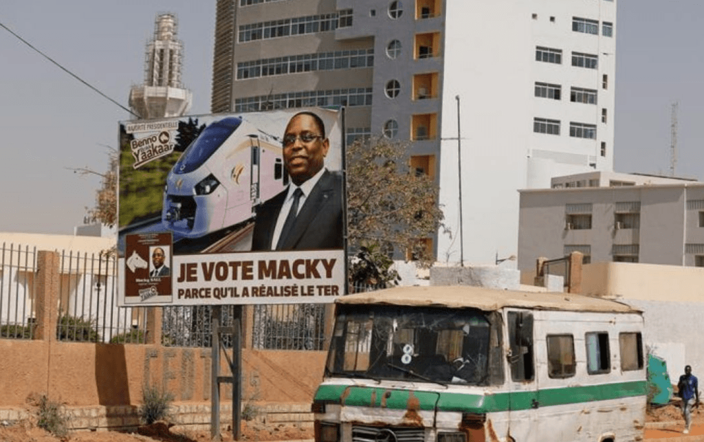 "Campaign poster for the upcoming presidential election shows Senegal's president Macky Sall and with the endorsement that means ""I vote Macky Sall because he brought about the TER (the Regional Express Train)"" in Dakar, Senegal. (Zohra Bensemra photo courtesy of Reuters)"