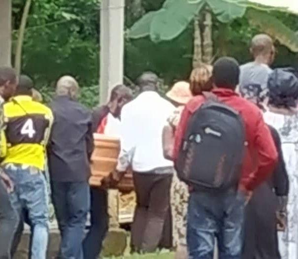 Pall bearers prepare for the burial of Lambert Lamba on Aug. 17, 2019.