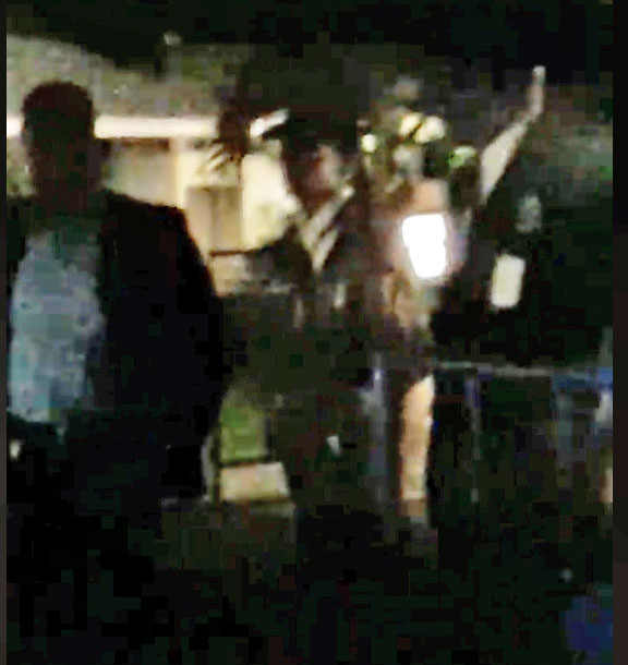 """Confronted by these Pegasus Hotel staff members, Rogerrie and his friends made videos in which they tried to explain what happened. In the dark video, you can hear them telling about the stones that were thrown and being called """"battymen"""". (Photo excerpted from video, courtesy of Facebook)"""