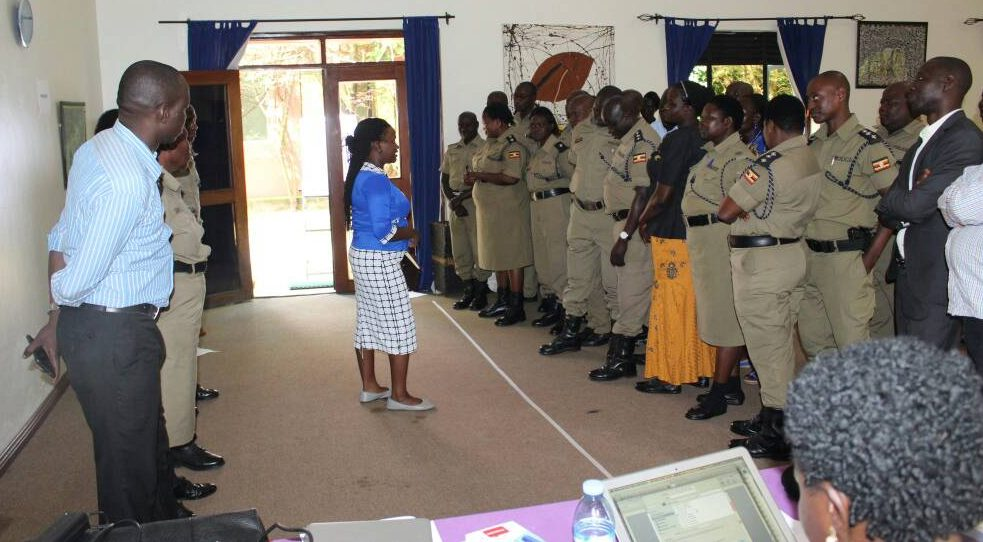 Ms Flavia Zalwango (middle), a staff member of HRAPF Uganda educates members of Uganda's security forces about human rights. The event was supported financially by Right Here Right Now Uganda.