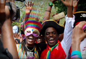 Dr Frank Mugisha, right, and other activists during a Ugandan gay pride event