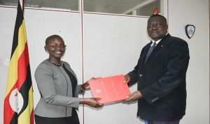 Jane Frances Abodo (left), Uganda's new Director of Public Prosecution, receiving instruments of power recently.