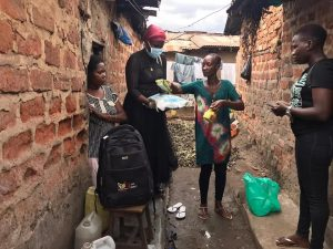 Sex-worker activists distribute relief food items to their peers in a Kampala brothel. (Courtesy photo)