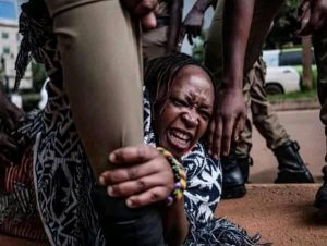 Dr. Stalla Nyanzi was wrestled to the ground by police during her arrest today in Kampala.