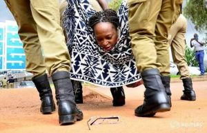 Dr Stella Nyanzi being whisked away by Police.