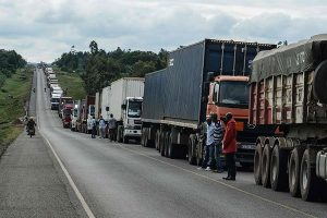Trucks await clearance to enter Uganda at Malaba border between Uganda and Kenya. (Photo courtesy of Daily Nation)
