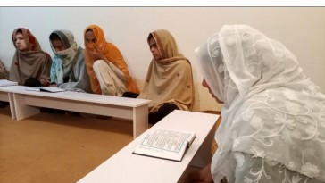 Trans students in class at Pakistan's first trans-only madrasa in Islamabad, Pakistan's capital. [Salahuddin photo courtesy of Reuters/Al Jazeera)