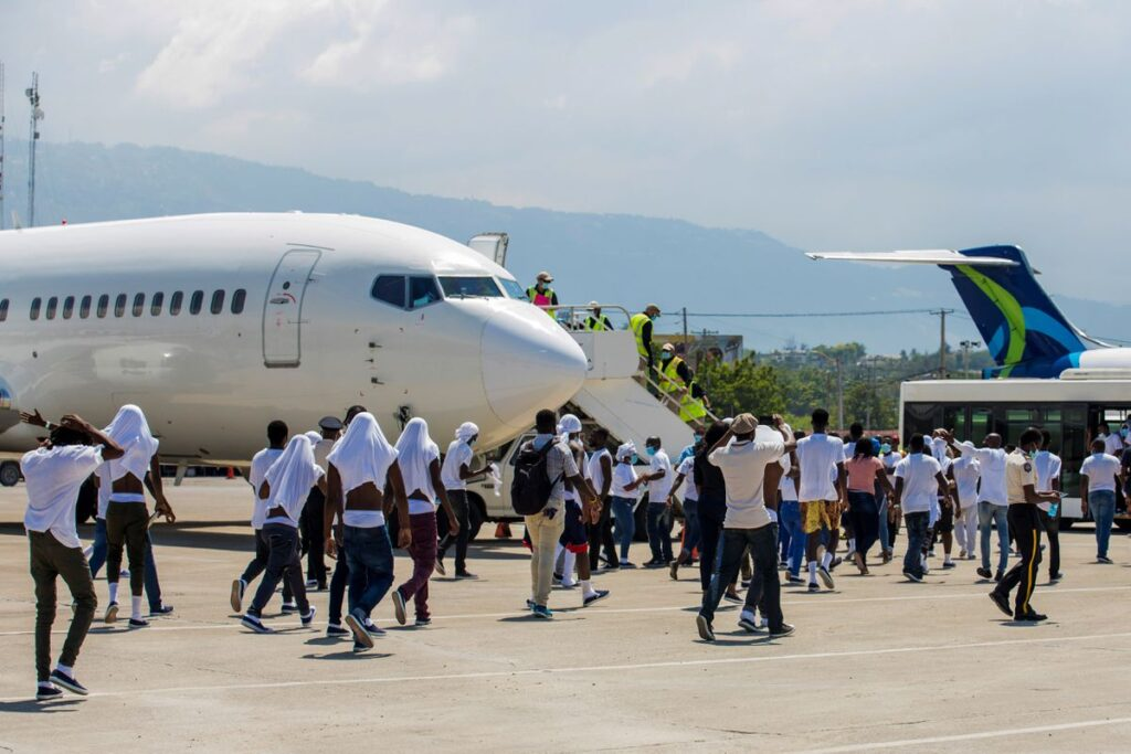 Haitian deportees prepare to leave the airport in Port-au-Prince, Haiti, on Sept. 21 after being flown there by U.S. authorities from Del Rio, Texas, where the would-be migrants sought asylum. (Ralph Tedy Erol photo courtesy of Reuters)